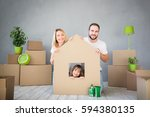 happy family playing into new... | Shutterstock . vector #594380135