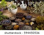healing herbs on wooden table ... | Shutterstock . vector #594450536