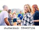group of friends at restaurant... | Shutterstock . vector #594457136