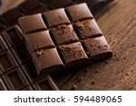 milk and dark chocolate on a... | Shutterstock . vector #594489065