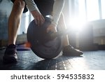 sportsman checking plate of... | Shutterstock . vector #594535832
