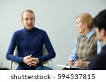 portrait of young man sitting... | Shutterstock . vector #594537815