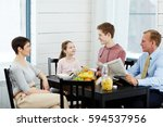family of four talking by table ... | Shutterstock . vector #594537956