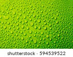 water drops on green background. | Shutterstock . vector #594539522