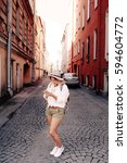 tourist using navigation app on ... | Shutterstock . vector #594604772