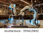 robots are welding in factory | Shutterstock . vector #594615842