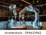 industrial robots are welding... | Shutterstock . vector #594615962
