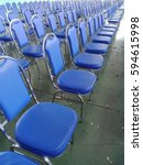 rows of blue chairs. | Shutterstock . vector #594615998