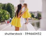 beautiful young mother with ... | Shutterstock . vector #594660452