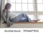 pregnant female is sitting on... | Shutterstock . vector #594687902