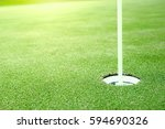 hole on green in golf course | Shutterstock . vector #594690326