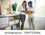two young entrepreneurs... | Shutterstock . vector #594725966