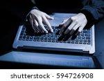 hooded computer hacker stealing ... | Shutterstock . vector #594726908