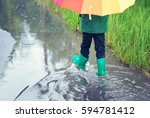 child walking in wellies in...   Shutterstock . vector #594781412