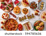 tapas mix and pinchos food from ... | Shutterstock . vector #594785636