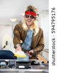 rockstar with a guitar holding... | Shutterstock . vector #594795176