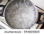 pot full of boiling water on... | Shutterstock . vector #594805805