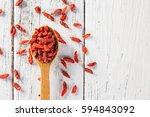 dry goji berry on old white... | Shutterstock . vector #594843092