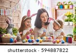 a mother and her daughter are... | Shutterstock . vector #594887822