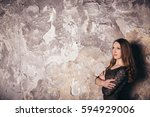 girl in the grunge studio  with ... | Shutterstock . vector #594929006