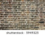 A very old brick wall close up background. - stock photo