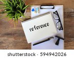 Small photo of Business concept - Top view notebook writing REFERENCE