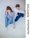 sad young couple sitting back...   Shutterstock . vector #594957242