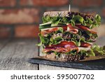 Small photo of Food. Delicious, big sandwich on the table