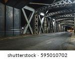 asphalt road under the steel... | Shutterstock . vector #595010702