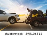 tow truck delivers the damaged... | Shutterstock . vector #595106516