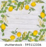 herbal frame with lemons over... | Shutterstock . vector #595112336