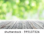 empty wooden table with blurred ... | Shutterstock . vector #595137326