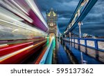 moving red bus on tower bridge... | Shutterstock . vector #595137362