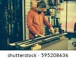 ski repair shop worker adjust... | Shutterstock . vector #595208636