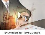 double exposure of businessman...   Shutterstock . vector #595224596