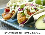close up of fresh fish tacos... | Shutterstock . vector #595252712