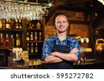 portrait of cheerful barman... | Shutterstock . vector #595272782