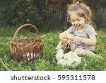 lovely kid with tiny chicken | Shutterstock . vector #595311578