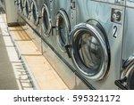 business laundry machine in... | Shutterstock . vector #595321172