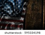 usa flag on a wood surface | Shutterstock . vector #595334198