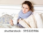 sick woman with cup of tea.... | Shutterstock . vector #595335986