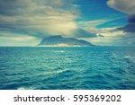 island on the horizon....   Shutterstock . vector #595369202