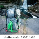 backpacking with hiking poles... | Shutterstock . vector #595415582
