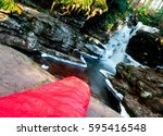 a red sleeping bag in front of... | Shutterstock . vector #595416548