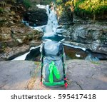 backpacking with hiking poles... | Shutterstock . vector #595417418