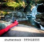 hiker on a sleeping bag in... | Shutterstock . vector #595418555