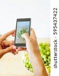 girl shoot photo on phone plate ...   Shutterstock . vector #595437422