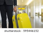 businessman and suitcase in the ... | Shutterstock . vector #595446152