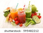 fresh juice or smoothie with... | Shutterstock . vector #595482212