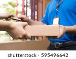 woman hand accepting a delivery ... | Shutterstock . vector #595496642
